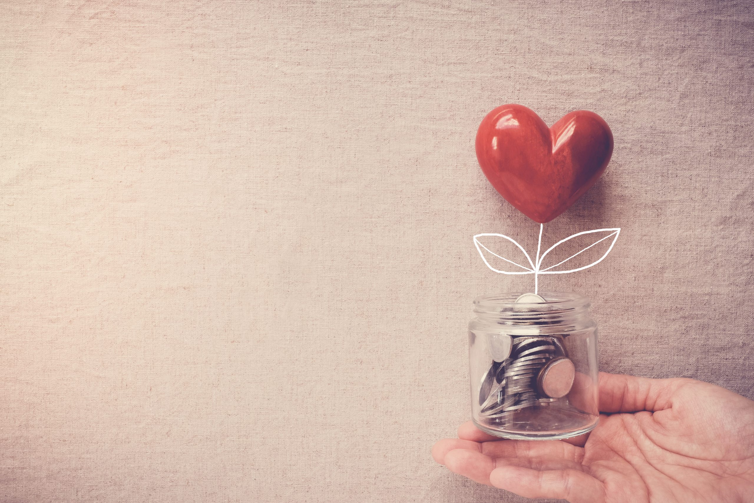 Skillup central hand-holding-jar-heart-tree-growing-money-coins